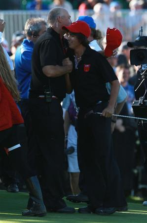 NEWPORT, WALES - OCTOBER 04:  (R) Rickie Fowler of the USA hugs Tom Lehman USA Team vice captain on the 18th green fatre halving in the singles matches during the 2010 Ryder Cup at the Celtic Manor Resort on October 4, 2010 in Newport, Wales.  (Photo by Andrew Redington/Getty Images)