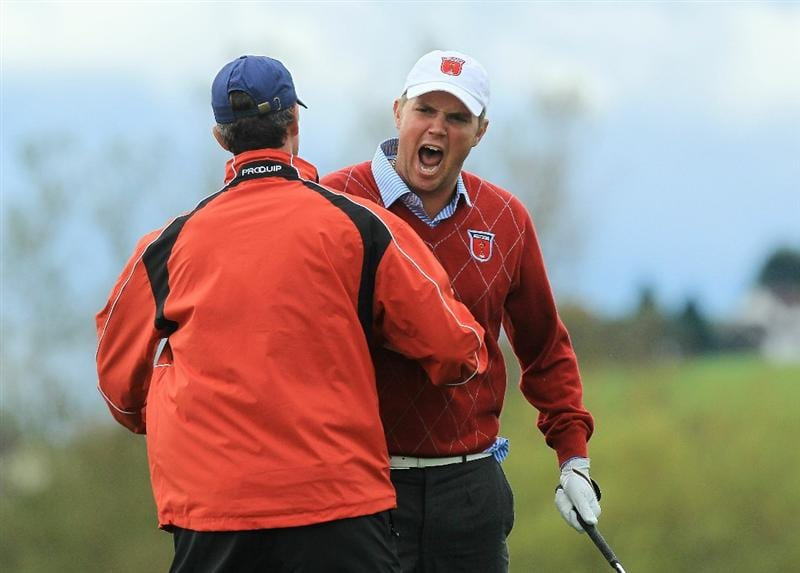 NEWPORT, WALES - OCTOBER 03:  Jeff Overton (R) of the USA celebrates after holing out for an eagle on the 8th hole during the  Fourball & Foursome Matches during the 2010 Ryder Cup at the Celtic Manor Resort on October 3, 2010 in Newport, Wales.  (Photo by David Cannon/Getty Images)