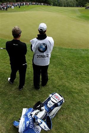 VIRGINIA WATER, ENGLAND - MAY 28:  Luke Donald of England waits with caddie John McClaren on the 17th hole during the third round of the BMW PGA Championship at the Wentworth Club on May 28, 2011 in Virginia Water, England.  (Photo by Warren Little/Getty Images)