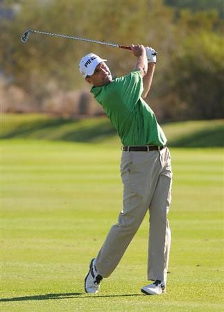 SCOTTSDALE, AZ - OCTOBER 26: Kevin Sutherland hits his approach shot into the 17th green during the fourth and final round of  the Fry's.Com Open held at Grayhawk Golf Club on October 26, 2008 in Scottsdale, Arizona. (Photo by Marc Feldman/Getty Images)