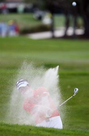 PALM BEACH GARDENS, FL - MARCH 08:  Y.E. Yang of South Korea hits out of the fairway bunker on the sixth hole during the final round of The Honda Classic at PGA National Resort and Spa on March 8, 2009 in Palm Beach Gardens, Florida.  (Photo by Doug Benc/Getty Images)