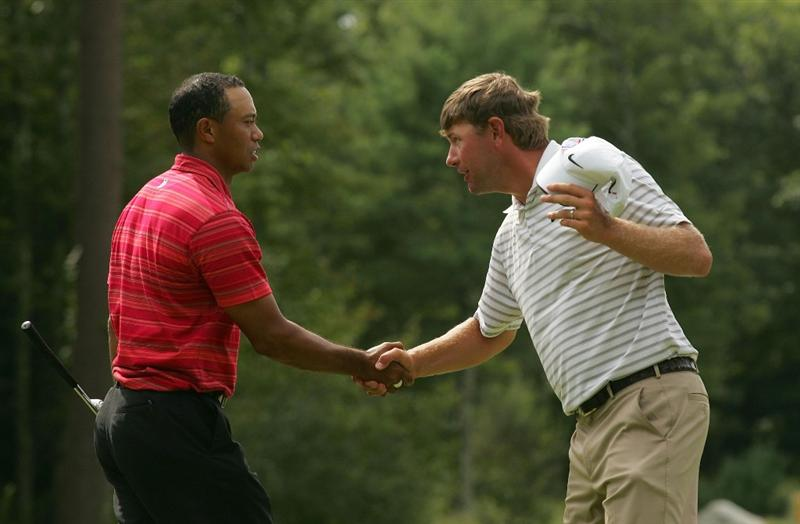 NORTON, MA - SEPTEMBER 07:  Tiger Woods (L) is Congratulated by Lucas Glover on the 18th green during the final round of the Deutsche Bank Championship at TPC Boston held on September 7, 2009 in Norton, Massachusetts.  (Photo by Michael Cohen/Getty Images)