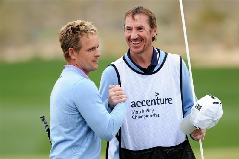 MARANA, AZ - FEBRUARY 26:  Luke Donald of England (L) celebrates his 6-up win over Matt Kuchar (not pictured) on the 13th hole with his caddie John McLaren (R) during the semifinal round of the Accenture Match Play Championship at the Ritz-Carlton Golf Club on February 26, 2011 in Marana, Arizona.  (Photo by Stuart Franklin/Getty Images)