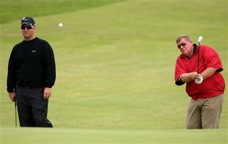 SOUTHPORT, UNITED KINGDOM - JULY 16:  John Daly of USA chips as David Duval of USA looks on during the third practice round of the 137th Open Championship on July 16, 2008 at Royal Birkdale Golf Club, Southport, England.  (Photo by Stuart Franklin/Getty Images)