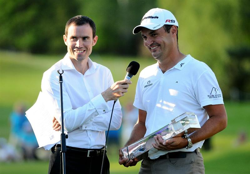 VIRGINIA WATER, ENGLAND - MAY 23:  Simon Khan of England makes a speech following his victory at the end of the final round of the BMW PGA Championship on the West Course at Wentworth on May 23, 2010 in Virginia Water, England.  (Photo by Richard Heathcote/Getty Images)