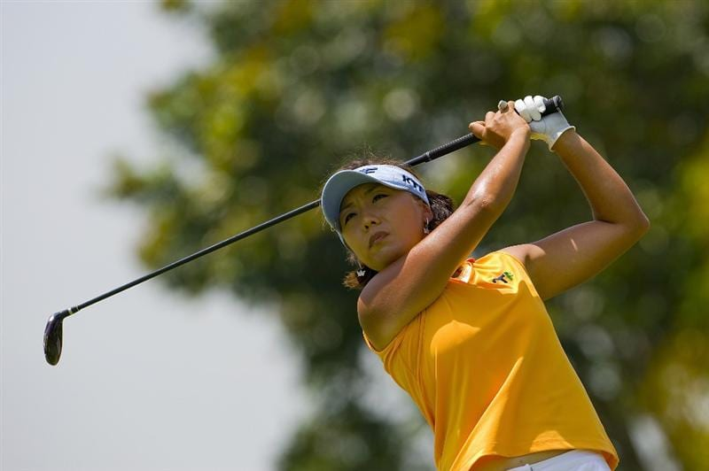 SINGAPORE - MARCH 06:  Mi Hyun Kim of South Korea hits an approach shot during the second round of HSBC Women's Champions at the Tanah Merah Country Club on March 6, 2009 in Singapore.  (Photo by Victor Fraile/Getty Images)