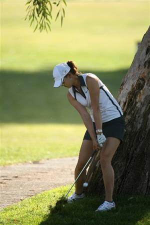 RANCHO MIRAGE, CA - APRIL 02:  Michelle Wie hits from beside a tree on the 15th hole during the first round of the Kraft Nabisco Championship at Mission Hills Country Club on April 2, 2009 in Rancho Mirage, California.  (Photo by Stephen Dunn/Getty Images)