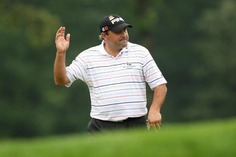 FARMINGDALE, NY - JUNE 19:  Angel Cabrera of Argentina waves to the gallery on the 13th green during the continuation of the first round of the 109th U.S. Open on the Black Course at Bethpage State Park on June 19, 2009 in Farmingdale, New York.  (Photo by Ross Kinnaird/Getty Images)