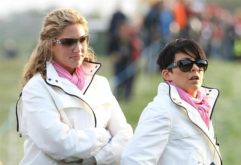 NEWPORT, WALES - OCTOBER 02:  Martin Kaymer's partner Allison Micheletti (L) and Laurae Westwood watch the action during the rescheduled Morning Fourball Matches during the 2010 Ryder Cup at the Celtic Manor Resort on October 2, 2010 in Newport, Wales.  (Photo by Ross Kinnaird/Getty Images)