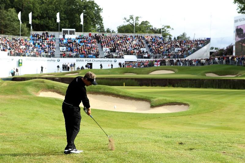 VIRGINIA WATER, ENGLAND - MAY 28:  Luke Donald of England hits his approach shot to the 18th green during the third round of the BMW PGA Championship at the Wentworth Club on May 28, 2011 in Virginia Water, England.  (Photo by Warren Little/Getty Images)