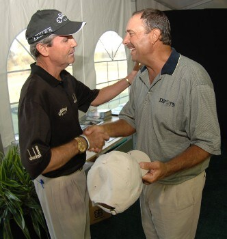Mark McNulty greets Brad Bryant in the media center after the final round of the Champion's TOUR Administaff Small Business Classic at Augusta Pines Country Club in Spring, Texas October 16, 2005Photo by Steve Grayson/WireImage.com