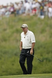 Allen Doyle walks off the green on hole 8 during the final round of the U.S. Senior Open at Prairie Dunes Country Club in Hutchinson,  Kansas on July 9, 2006.Photo by G. Newman Lowrance/WireImage.com