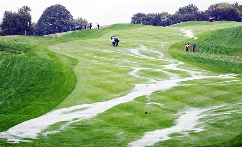 NEWPORT, WALES - OCTOBER 01:  The 18th fairway is waterlogged as rain falls and play is suspended during the Morning Fourball Matches during the 2010 Ryder Cup at the Celtic Manor Resort on October 1, 2010 in Newport, Wales.  (Photo by Jamie Squire/Getty Images) *** BESTPIX ***