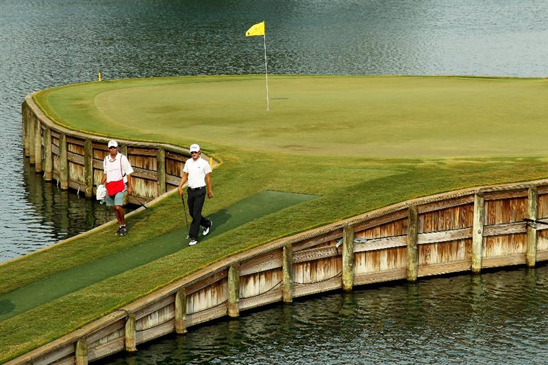 PONTE VEDRA BEACH, FL - MAY 13:  Michael Sim of Australia and his caddie Matthew Tritton walk off the 17th hole during the second round of THE PLAYERS Championship held at THE PLAYERS Stadium course at TPC Sawgrass on May 13, 2011 in Ponte Vedra Beach, Florida.  (Photo by Mike Ehrmann/Getty Images)