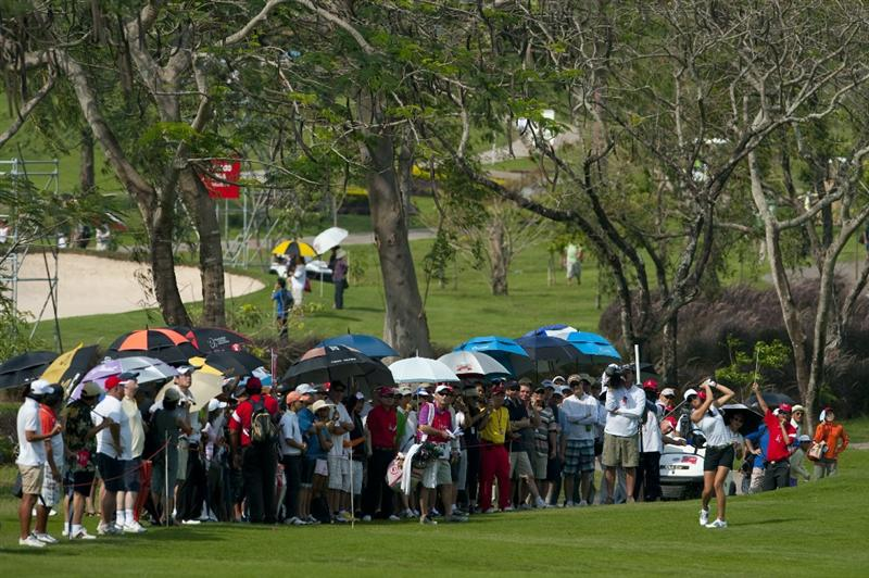 CHON BURI, THAILAND - FEBRUARY 19:  Michelle Wie of USA plays her second shot on the 11th hole during day three of the LPGA Thailand at Siam Country Club on February 19, 2011 in Chon Buri, Thailand.  (Photo by Victor Fraile/Getty Images)