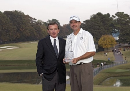 PGA TOUR Commissioner Tim Finchem and Bart Bryant after winning THE TOUR Championship at East Lake Golf Club in Atlanta, Georgia on November 6, 2005.Photo by Sam Greenwood/WireImage.com