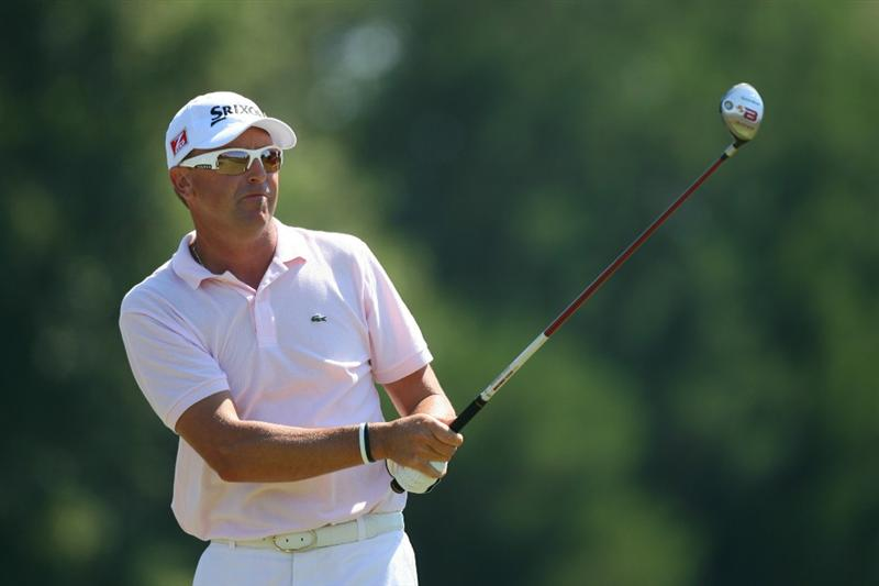 SEA ISLAND, GA - OCTOBER 10: Robert Allenby watches his tee shot on the fourth hole during the final round of the McGladrey Classic at Sea Island's Seaside Course on October 10, 2010 in Sea Island, Georgia. (Photo by Hunter Martin/Getty Images)