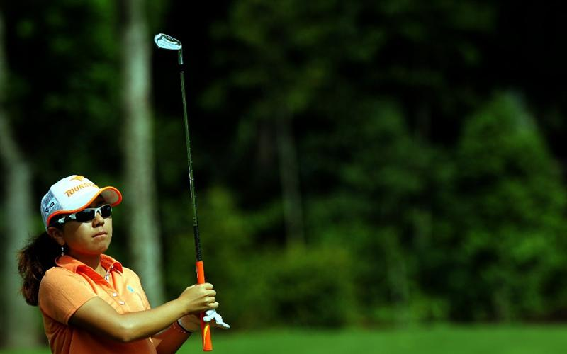 KUALA LUMPUR, MALAYSIA - OCTOBER 24 : Mika Miyazato of Japan watches her 2nd shot on the 1st hole during the Final Round of the Sime Darby LPGA on October 24, 2010 at the Kuala Lumpur Golf and Country Club in Kuala Lumpur, Malaysia. (Photo by Stanley Chou/Getty Images)