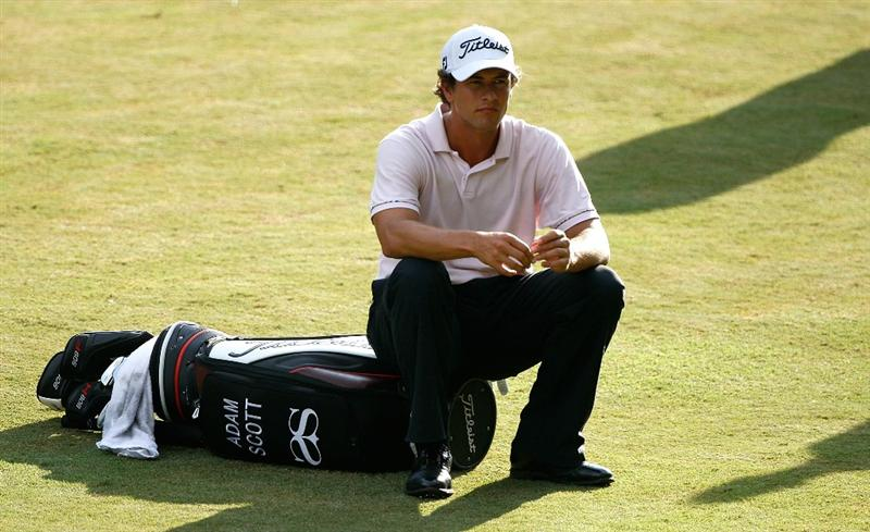 GREENSBORO, NC - AUGUST 20:  Adam Scott of Australia sits on his bag as he waits to hit during the first round of the Wyndham Championship at Sedgefield Country Club on August 20, 2009 in Greensboro, North Carolina  (Photo by Streeter Lecka/Getty Images)
