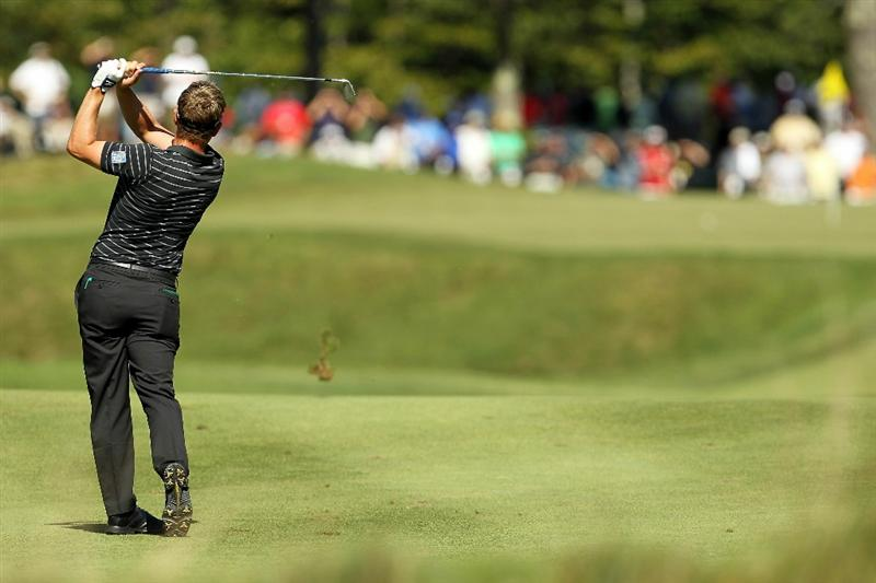 NORTON, MA - SEPTEMBER 06:  Luke Donald of England hits an approach on the fifth hole during the final round of the Deutsche Bank Championship at TPC Boston on September 6, 2010 in Norton, Massachusetts.  (Photo by Mike Ehrmann/Getty Images)