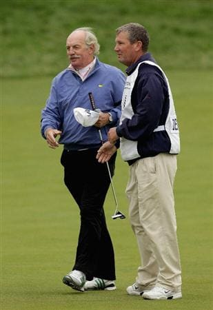 ST ANDREWS, SCOTLAND - OCTOBER 10:  Irish businessman Dermot Desmond is congratulated by his caddie on the 18th green during the final round of The Alfred Dunhill Links Championship at The Old Course on October 10, 2010 in St Andrews, Scotland.  (Photo by Andrew Redington/Getty Images)