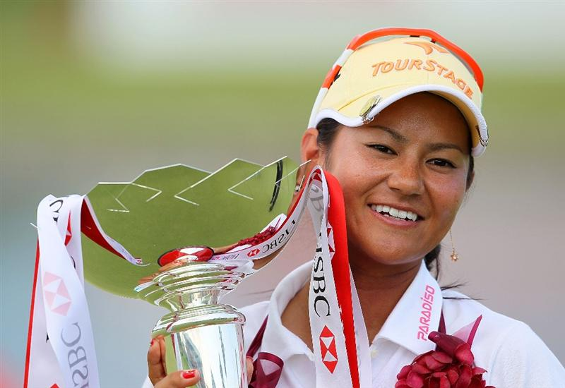 SINGAPORE - FEBRUARY 28:  Ai Miyazato of Japan holds the winner's trophy after winning the HSBC Women's Champions at Tanah Merah Country Club on February 28, 2010 in Singapore, Singapore.  (Photo by Andy Lyons/Getty Images)