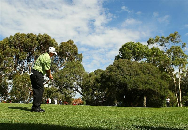 PERTH, AUSTRALIA - NOVEMBER 21:  Peter Senior of Australia plays a chip shot on the 16th hole during day three of the 2010 Australian Senior Open at Royal Perth Golf Club on November 21, 2010 in Perth, Australia.  (Photo by Paul Kane/Getty Images)