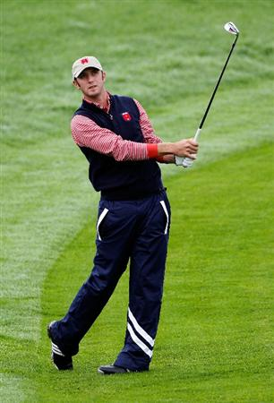 NEWPORT, WALES - SEPTEMBER 30:  Dustin Johnson of the USA hits a shot during a practice round prior to the 2010 Ryder Cup at the Celtic Manor Resort on September 30, 2010 in Newport, Wales.  (Photo by Sam Greenwood/Getty Images)
