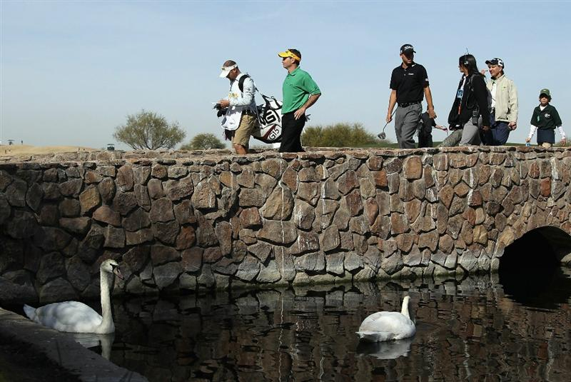SCOTTSDALE, AZ - FEBRUARY 06:  Mark Wilson and Bill Haas cross the 15th hole bridge during the third round of the Waste Management Phoenix Open at TPC Scottsdale on February 6, 2011 in Scottsdale, Arizona.  (Photo by Christian Petersen/Getty Images)