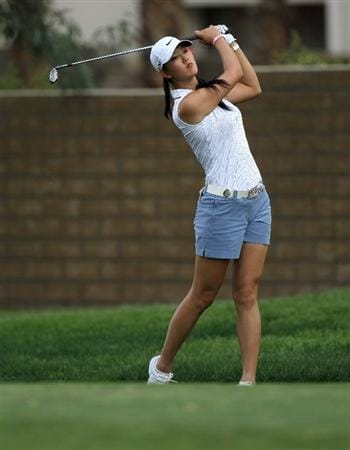RANCHO MIRAGE, CA - APRIL 02:  Michelle Wie hits her second shot on the 15th hole during the third round of the Kraft Nabisco Championship at Mission Hills Country Club on April 2, 2011 in Rancho Mirage, California.  (Photo by Stephen Dunn/Getty Images)