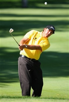 AKRON, OH - AUGUST 02:  Phil Mickelson of USA plays his approach shot on the 11th hole during third round of the World Golf Championship Bridgestone Invitational at Firestone Country Club on August 2, 2008 in Akron, Ohio.  (Photo by Stuart Franklin/Getty Images)