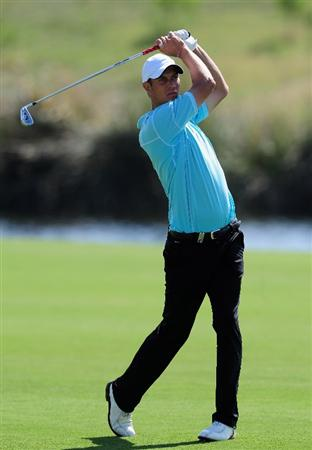 VILAMOURA, PORTUGAL - OCTOBER 15:  Mads Vibe-Hastrup of Denmark plays his approach shot on the 18th hole during the first round of the Portugal Masters at the Oceanico Victoria Golf Course on October 15, 2009 in Vilamoura, Portugal.  (Photo by Stuart Franklin/Getty Images)
