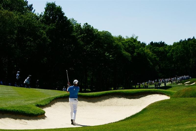 VIRGINIA WATER, ENGLAND - MAY 23:  Robert Karlsson of Sweden plays a bunker shot at the 1st hole during the final round of the BMW PGA Championship on the West Course at Wentworth on May 23, 2010 in Virginia Water, England.  (Photo by Ker Robertson/Getty Images)