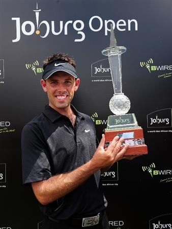 JOHANNESBURG, SOUTH AFRICA - JANUARY 17:  Charl Schwartzel of South Africa holds the winner's trophy at the Joburg Open at Royal Johannesburg and Kensington Golf Club on January 17, 2010 in Johannesburg, South Africa.  (Photo by Stuart Franklin/Getty Images)