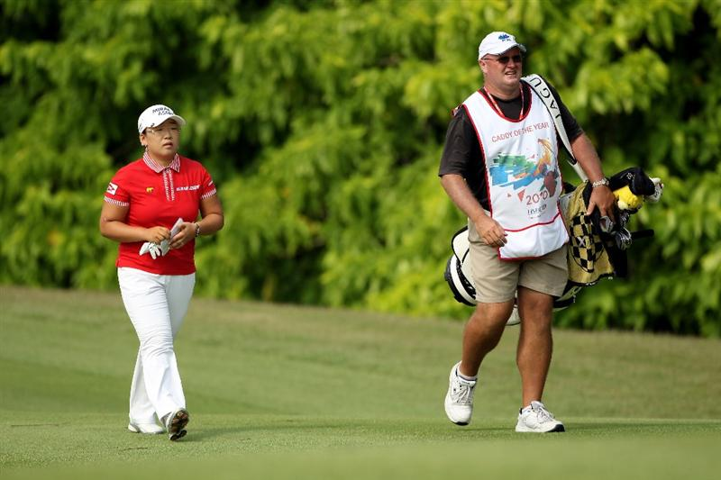 SINGAPORE - FEBRUARY 28:  Jiyai Shin of South Korea walks with her caddie Dean Herden on the fifth hole during the final round of the HSBC Women's Champions at the Tanah Merah Country Club on February 28, 2010 in Singapore.  (Photo by Andrew Redington/Getty Images)