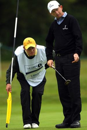 SUNNINGDALE, ENGLAND - JUNE 08:  Peter Lawrie of Ireland and his caddie Dermot Byrne line up a putt on the first hole of the Old Course during the morning's play at The Open Championship International Final Qualifying on June 8, 2009 at Sunningdale Golf Club in Sunningdale, England.  (Photo by Andrew Redington/Getty Images)