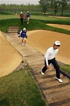 BEIJING - APRIL 18:  Seung-yul Noh of Korea walks off the 4th green during the 2nd round of the Volvo China Open at the Beijing CBD International Golf Club on April 18, 2008 in Beijing, China.  (Photo by Ian Walton/Getty Images)