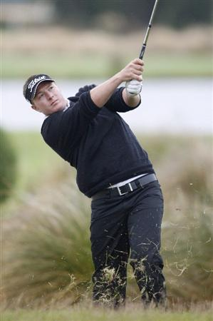 CHRISTCHURCH, NEW ZEALAND - JANUARY 22:  Anthony Doyle of New Zealand plays his approach shot out of the rough at Clearwater Golf Course on January 22, 2010 in Christchurch, New Zealand.  (Photo by Martin Hunter/Getty Images)