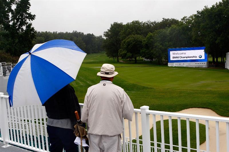 ST. LOUIS - SEPTEMBER 04:  Fans overlook the 18th green as rain postpones the first round of the BMW Championship on September 4, 2008 at Bellerive Country Club in St. Louis, Missouri.  (Photo by Jamie Squire/Getty Images)