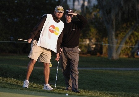 Joe Ogilvie and his caddy line up a putt on the first hole in  the second  round of the Bay Hill Invitational March 18, 2005 in Orlando.