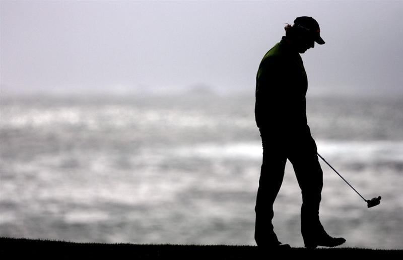 PEBBLE BEACH, CA - FEBRUARY 14: Mathew Goggin walks up the 18th hole at Pebble Beach Golf Course during the third round of the AT&T Pebble Beach National Pro-Am on February 14, 2009 in Pebble Beach, California. (Photo by Max Morse/Getty Images for Kodak)