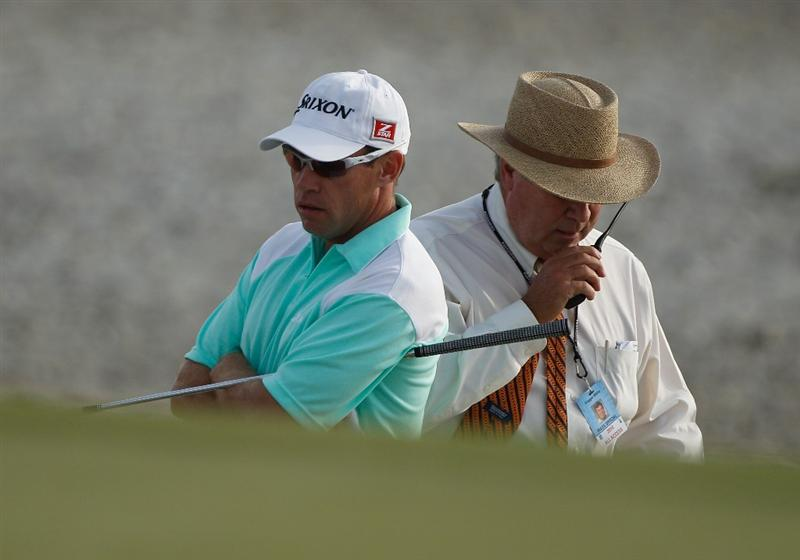 HILTON HEAD ISLAND, SC - APRIL 18:  Brian Davis (L) of England waits for a ruling from PGA Tour rules official Slugger White from the beach on the first playoff hole during the final round of the Verizon Heritage at the Harbour Town Golf Links on April 18, 2010 in Hilton Head lsland, South Carolina.  (Photo by Scott Halleran/Getty Images)