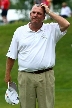 OAKVILLE, ONTARIO, CANADA - JULY 25: Mark Calcavecchia takes his hat off at the end of his round during round two of the RBC Canadian Open at Glen Abbey Golf Club on July 25, 2009 in Oakville, Ontario, Canada.  (Photo by Chris McGrath/Getty Images)