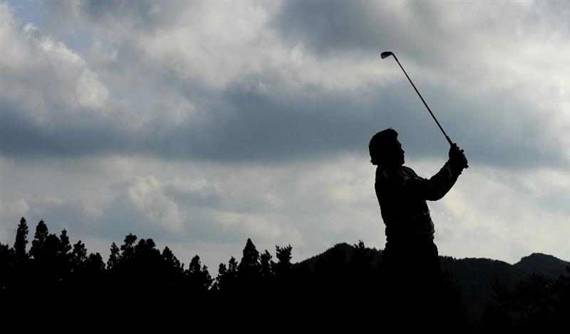 JEJU, SOUTH KOREA - APRIL 25:  Robert - Jan Derksen of The Netherlands plays his approach shot on the 15th hole during the third round of the Ballantine's Championship at Pinx Golf Club on April 25, 2009 in Jeju, South Korea.  (Photo by Stuart Franklin/Getty Images)