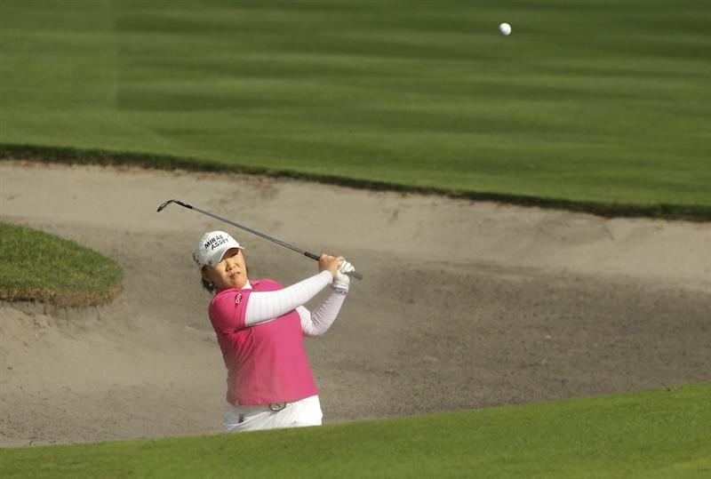 MELBOURNE, AUSTRALIA - FEBRUARY 06:  Jiyai Shin of South Korea plays a shot out of the bunker during day four of the Women's Australian Open at The Commonwealth Golf Club on February 6, 2011 in Melbourne, Australia.  (Photo by Lucas Dawson/Getty Images)