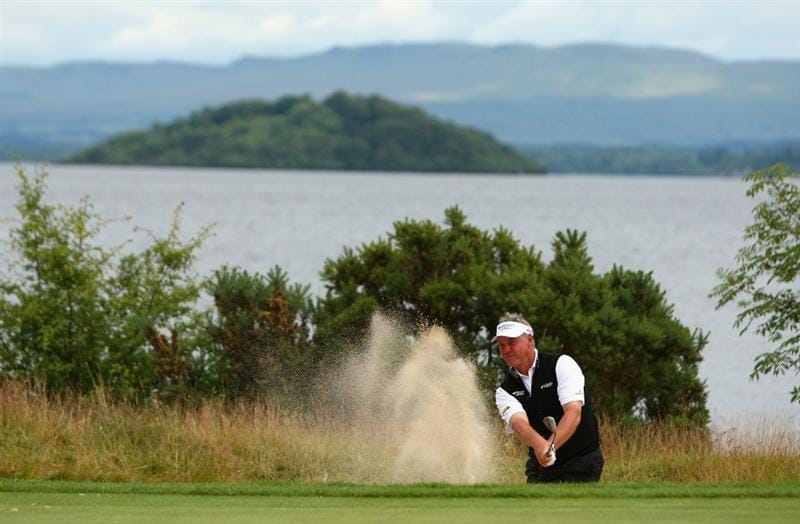 LUSS, SCOTLAND - JULY 08:  Darren Clarke of Northern Ireland hits out of a bunker during the Pro Am prior to The Barclays Scottish Open at Loch Lomond Golf Club on July 08, 2009 in Luss, Scotland.  (Photo by Richard Heathcote/Getty Images)