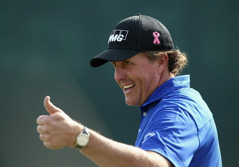 SCOTTSDALE, AZ - FEBRUARY 05:  Phil Mickelson reacts to the crowd on the 16th hole during the second round of the Waste Management Phoenix Open at TPC Scottsdale on February 5, 2011 in Scottsdale, Arizona.  (Photo by Christian Petersen/Getty Images)