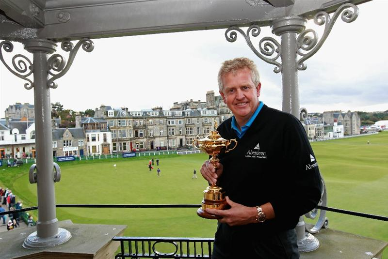 ST ANDREWS, SCOTLAND - OCTOBER 06:  Colin Montgomerie of Scotland poses with The Ryder Cup trophy on the balcony of the R&A clubhouse after a practice round for The Alfred Dunhill Links Championship at Carnoustie Golf Links on October 6, 2010 in St Andrews, Scotland.  (Photo by Andrew Redington/Getty Images)