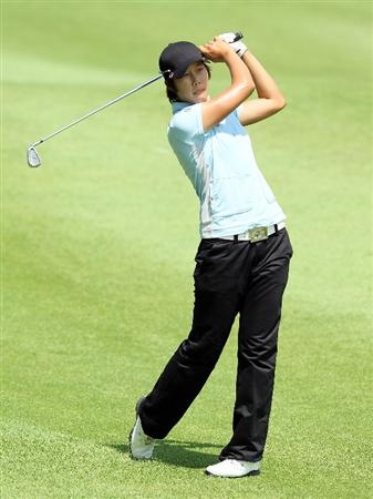 SINGAPORE - FEBRUARY 26:  Song-Hee Kim of South Korea hits her second shot on the 6th hole during the second round of the HSBC Women's Champions at Tanah Merah Country Club on February 26, 2010 in Singapore, Singapore.  (Photo by Andy Lyons/Getty Images)