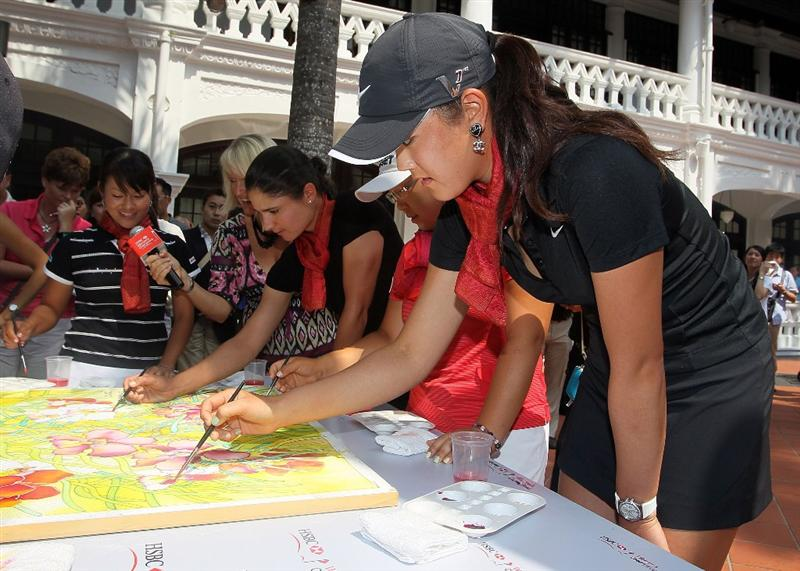 SINGAPORE - FEBRUARY 23:  Michelle Wie of the USA  paints during a photocall at the Raffles Hotel prior to the HSBC Women's Champions at Tanah Merah Country Club on February 23, 2010 in Singapore, Singapore.  (Photo by Andy Lyons/Getty Images)